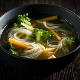 Beef broth, rice noodles, broccoli and carrots